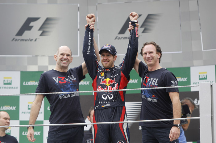 Vettel champion as Button wins thriller