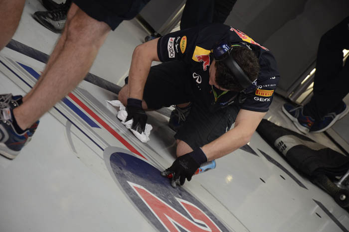 Mark Webber's garage floor being wiped spanking-clean right after he left the garage.