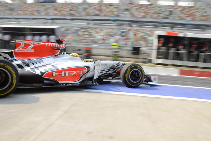 Narain Karthikeyan leaves the HRT pit garage for his first lap of the Buddh Circuit.