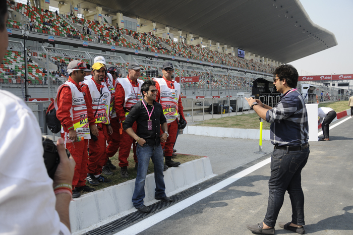 Pit marshals strike a pose for the camera.