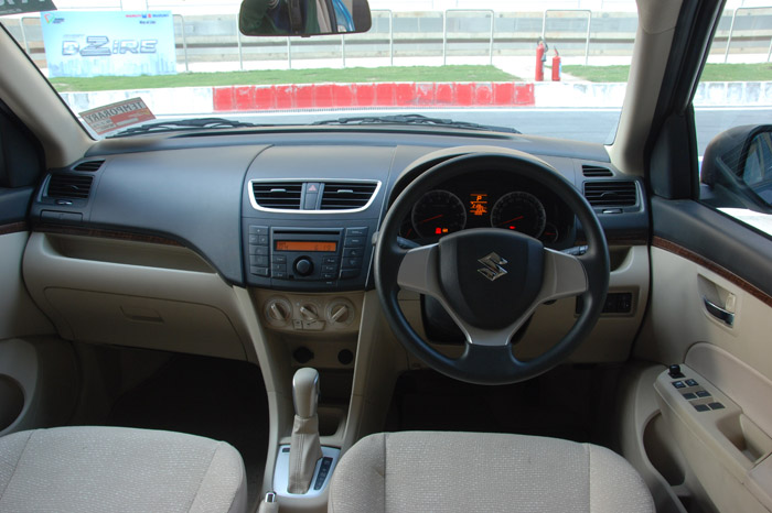 Cabin design is identical to the Swift's though the use of beige plastics on the lower portion of the dashboard and door pads enhance the ambience inside.