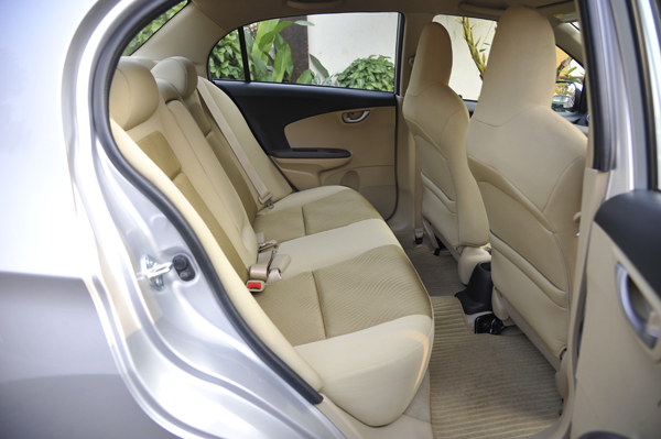 Rear seat cushioning is thicker than the Brio. Ample legroom as well.