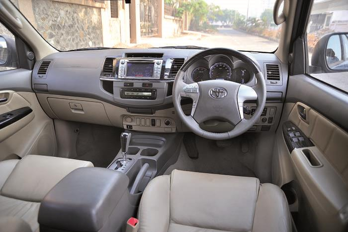 Interiors unchanged, save for touch-screen audio and Camry-soured steering wheel . Piano black wood trim looks good.
