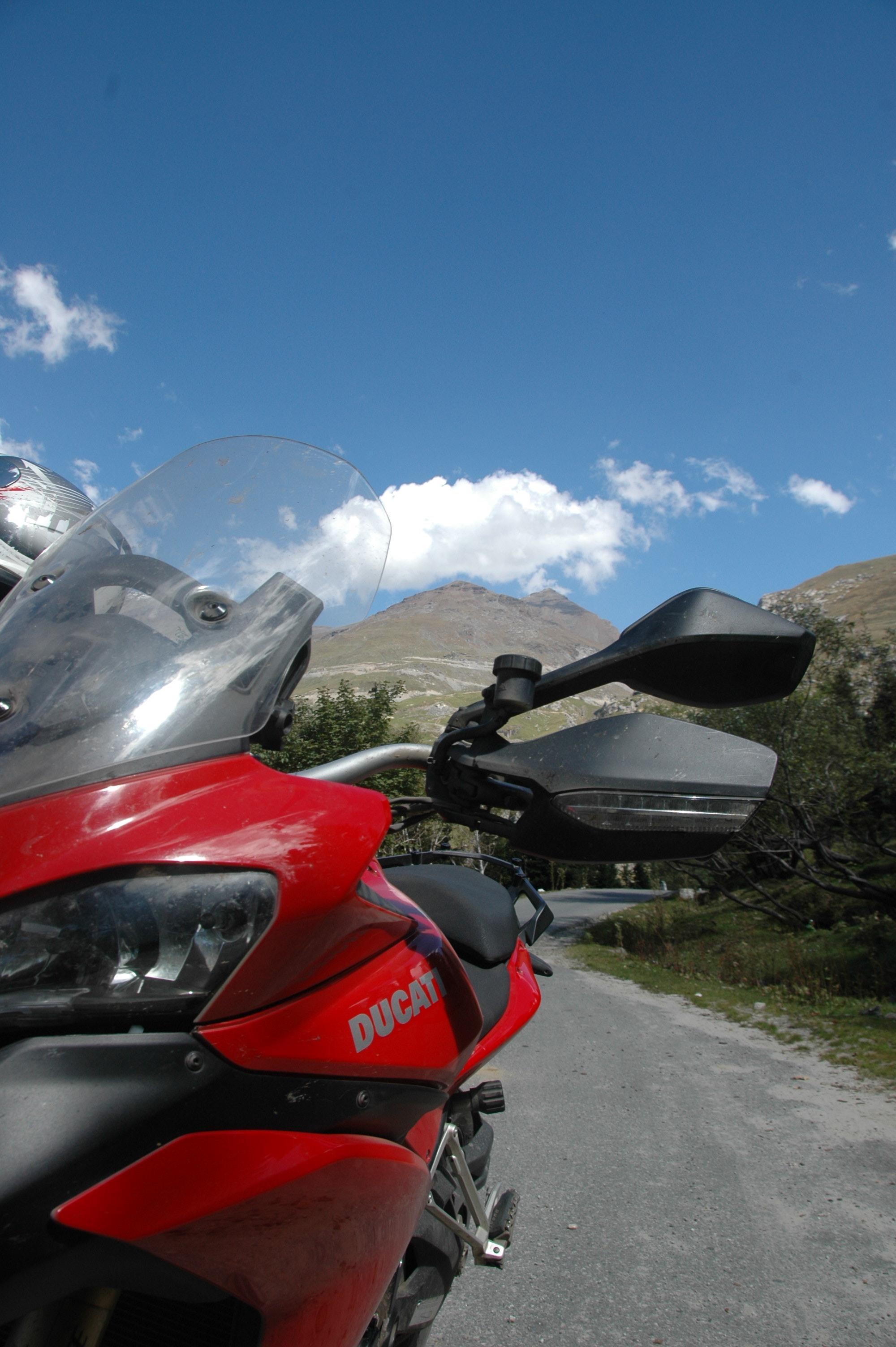 Red Ducati, blue skies, crisp mountain air - the setting for an epic ride.